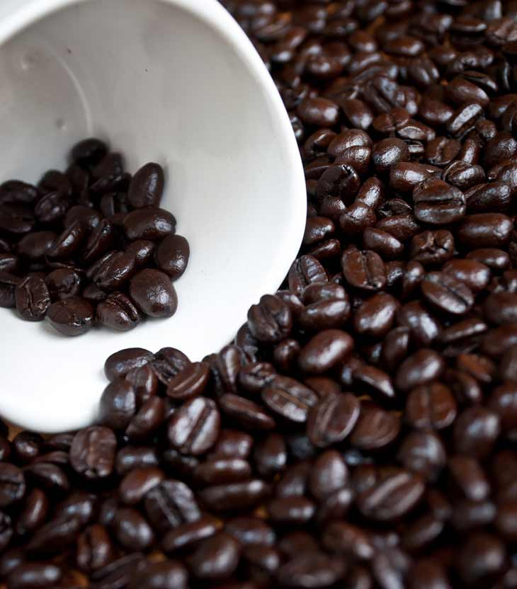 dark coffee beans in cup
