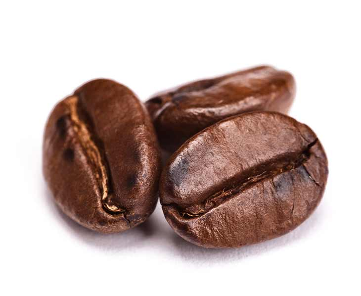three coffee beans close up