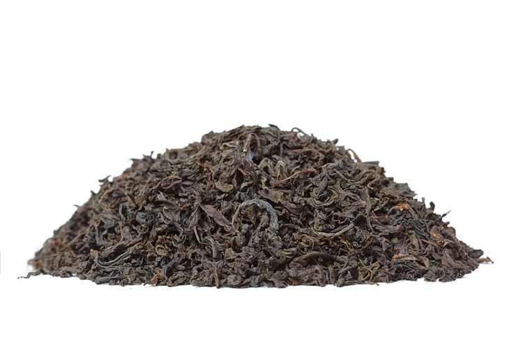 a pile of black tea leaves