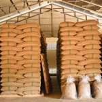 coffee bean sacks stacked warehouse