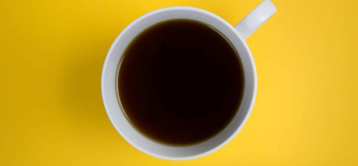 yellow-flatlay-black-coffee-cup-white-handle-mug-minimal