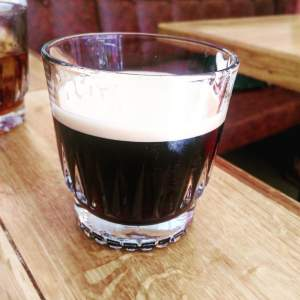 Cold-Brew-coffee-glass-wood-surface-table