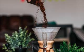 coffee-pour-into-filter-pour-over-ground-grounds-coffee-pollards-green-plants-hand
